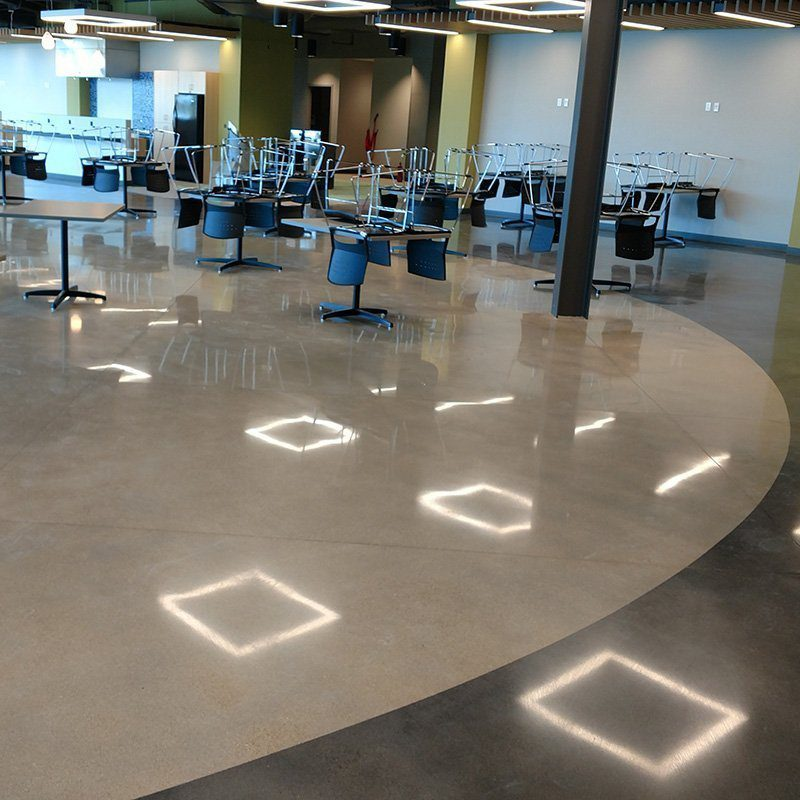 Zeeland Cafeteria Dyed Polished Concrete Floor with Design